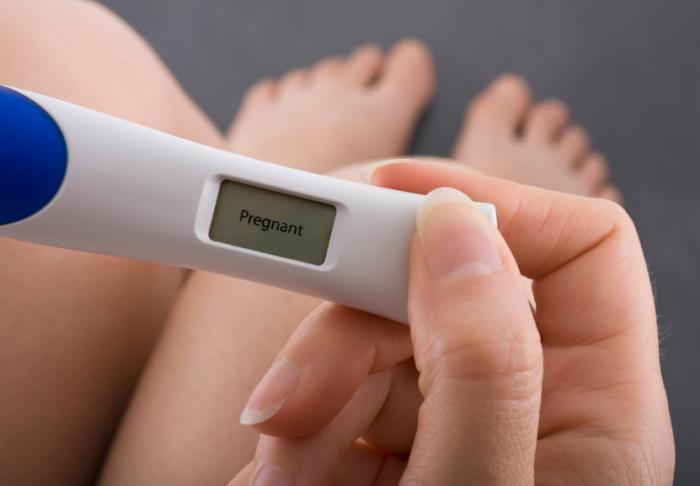 woman-holding-pregnancy-test